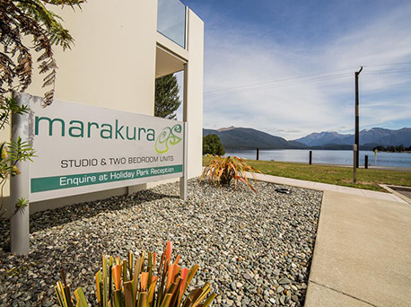Marakura luxury motel units in foreground showing the view of Lake Te Anau and mountains in background