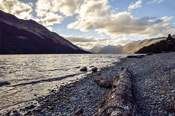 View from the gravelly shores of Lake Mavora looking over the water towards the mountains