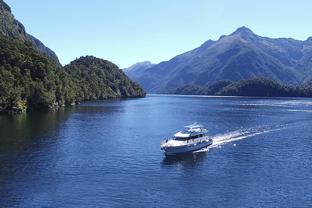 Aerial view of the MV Southern Secret cruising on Doubtful Sound