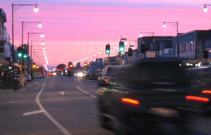 Street view in Invercargill just on sunset with pink sky and street lights on