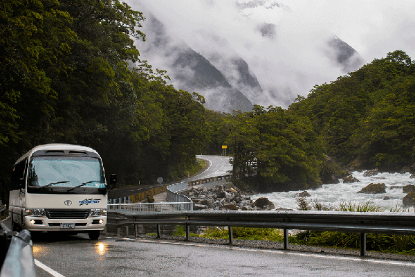 Tracknet bus crossing a bridge on the Milford Road alongside Cleddau river