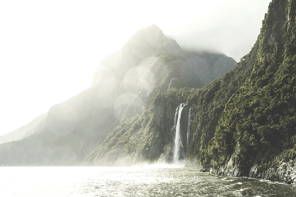 Dramatic waterfall falling into Milford Sound from a hanging valley