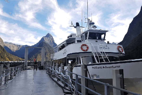 Close up of Cruise Milford's vessel, Milford Adventurer, tied alongside the Milford Sound Wharf