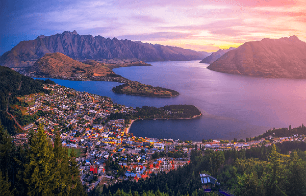 Aerial view over Queenstown city with Lake Wakatipu and Remarkables mountain range in the background