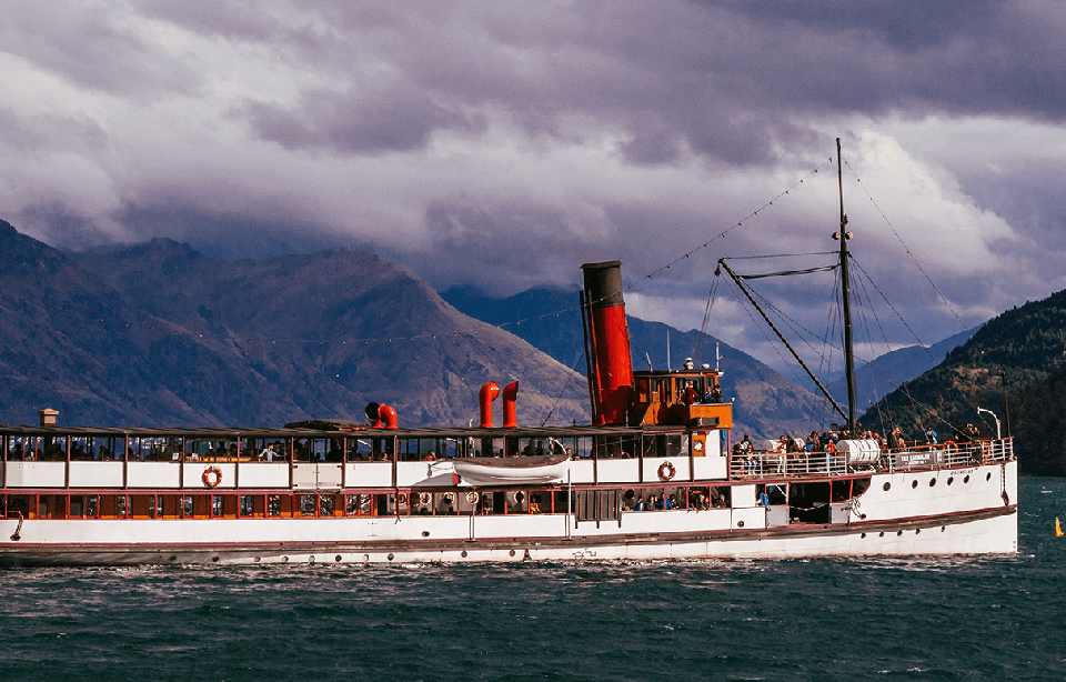 The TSS Earnslaw steamship on the calm water of Lake Wakatipu