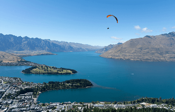 Paragliding high above Queenstown with Lake Wakatipu in the background