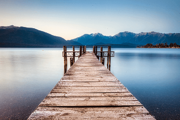 Yacht Club Wharf on Lake Te Anau with view towards the mountains